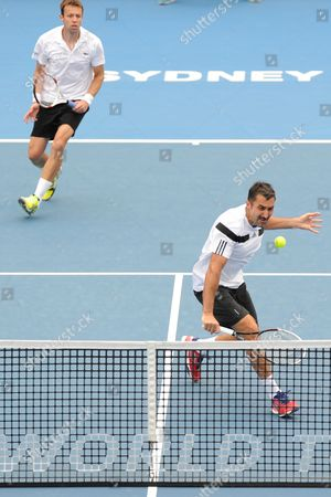 Daniel Nestor of Canada (left) and Nenad Zimonjic of Serbia (right) in Action Against Rohan Bopanna of India and Aisam-ul-haq Qureshi of Pakistan During the Men's Doubles Finals of the Apia International at Olympic Park in Sydney Australia 11 January 2014 Australia Sydney