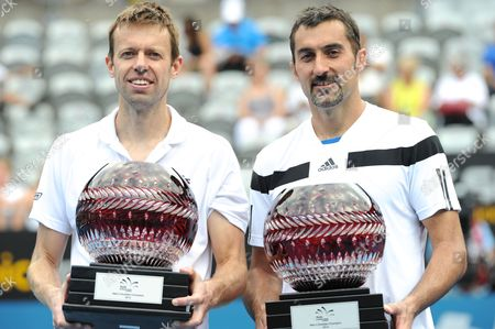 Daniel Nestor of Canada (left) and Nenad Zimonjic of Serbia (right) Hold the Winners Trophy After Their Win Against Rohan Bopanna of India and Aisam-ul-haq Qureshi of Pakistan in the Men's Doubles Finals of the Apia International at Olympic Park in Sydney Australia 11 January 2014 Australia Sydney