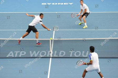 Daniel Nestor of Canada (r) and Nenad Zimonjic of Serbia (l) in Action Against Rohan Bopanna of India and Aisam-ul-haq Qureshi of Pakistan During the Men's Doubles Finals of the Apia International at Olympic Park in Sydney Australia 11 January 2014 Australia Sydney