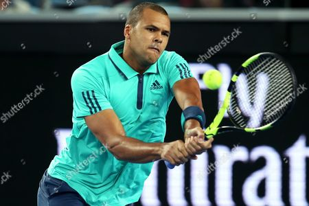 Jo-wilfried Tsonga of France Plays a Backhand Against Pierre-hugues Herbert of France During Their Third Round Match on Day Five of the Australian Open Tennis Tournament in Melbourne Australia 22 January 2016 Australia Melbourne