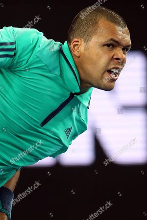 Jo-wilfried Tsonga of France Serves to Pierre-hugues Herbert of France During Their Third Round Match on Day Five of the Australian Open Tennis Tournament in Melbourne Australia 22 January 2016 Australia Melbourne