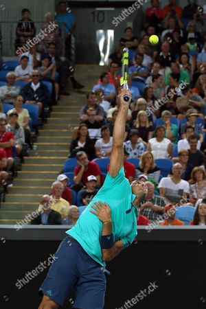 Jo-wilfried Tsonga of France Serves Against Pierre-hugues Herbert of France During Their Third Round Match on Day Five of the Australian Open Tennis Tournament in Melbourne Australia 22 January 2016 Australia Melbourne