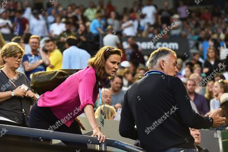 Former Us Tennis Player Pam Shriver Speaks with Crowd Members As Play is Suspended After Nigel Sears Coach of Serbia's Ana Ivanovic Collapsed on the Stairs of the Rod Laver Arena During the Third Round Match Between Ivanovic and Madison Keys of the Usa at the Australian Open Grand Slam Tennis Tournament in Melbourne Australia 23 January 2016 Australia Melbourne