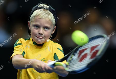 Cruz Hewitt the Son of Lleyton Hewitt of Australia Returns to Roger Federer of Switzerland During a Warm Up For Their Fast4 Tennis Exhibition Match in Sydney Australia 12 January 2015 Australia Sydney