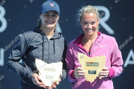 Klara Zakopalova of the Czech Republic (r) and Monica Niculescu of Romania (l) Pose with Trophies After Their Doubles Final Match of the Hobart International Against Lisa Raymond of Us and Shuai Zhang of China at the Domain Tennis Centre in Hobart Tasmania Australia 11 January 2014 Australia Hobart