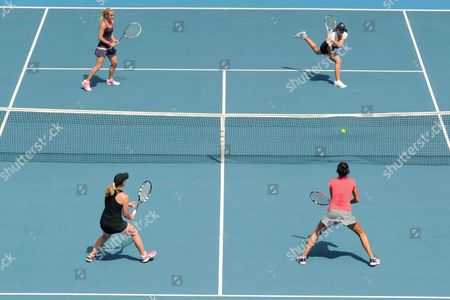 Stock Picture of Lisa Raymond of the Us (b-l) and Shuai Zhang of China (b-r) Receive a Ball From Klara Zakopalova of Czech Republic (t-l) and Monica Niculescu of Romania (t-r)during the Doubles Finals of the Hobart International at the Domain Tennis Centre in Hobart Tasmania Australia 11 January 2014 Australia Hobart
