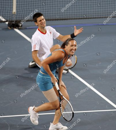Serbia's Jelena Jankovic and Novak Djokovic Share a Joke As They Miss a Point in the Mixed Doubles Match Against Tatiana Golovin and Arnaud Clement For France (not Pictured) During Session 7 of the Hopman Cup Tennis Tournament in Perth 02 January 2008 Serbia Won the Match 5-7 6-4 7-6 (10-4) Australia Perth