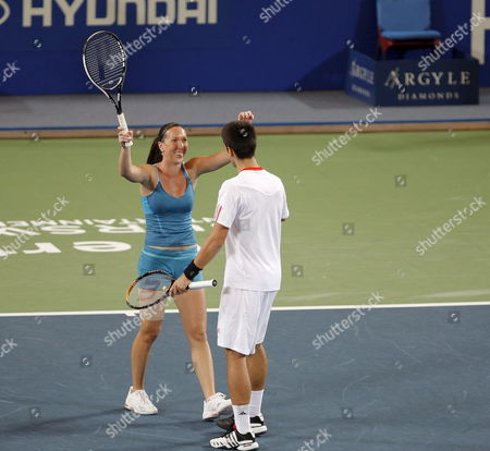 Serbia's Jelena Jankovic and Novak Djokovic Celebrate Their Win in the Mixed Doubles Match Against Tatiana Golovin and Arnaud Clement For France (not Pictured) During Session 7 of the Hopman Cup Tennis Tournament in Perth 02 January 2008 Serbia Won the Match 5-7 6-4 7-6 (10-4) Australia Perth