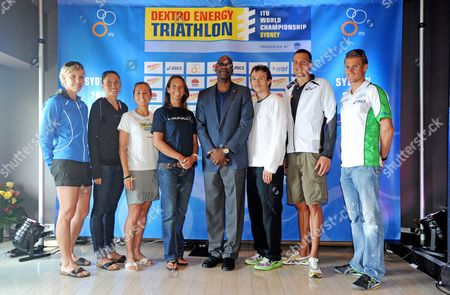 Triathletes From L-r Lisa Norden Emma Moffatt Emma Snowsill Simon Whitfield Jan Frodeno and Brad Kahlefeldt Pose For Photographs with Australian Surfer Layne Beachley (c Left) and Olympic Gold Medalist Edwin Moses (c) at a Press Conference Ahead of the Opening Round of the Triathalon Itu World Championship Series in Sydney 09 April 2010 the Triathlon Itu World Championship Series Starts on Sunday in Sydney with the World's Fastest Triathletes Ready to Begin Their Quest to Become the 2010 World Champion Australia Sydney