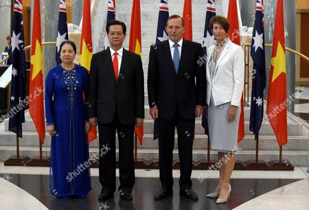 Stock Photo of (l-r) Madame Tran Thanh Kiem Vietnam's Prime Minister Nguyen Tan Dung Australia's Prime Minister Tony Abbott and Wife Margie Abbott at a Ceremonial Welcome at Parliament House in Canberra Australia 18 March 2015 Australia Canberra
