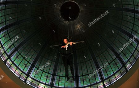 Australian Violinist Shenzo Gregorio Performs While Being Suspended From the Dome of the Queen Victoria Building in Sydney Australia on 16 June 2011 the Performance is the First of a Series of Free Cultural Events Happening Under the Queen Victoria Building Dome Australia Sydney