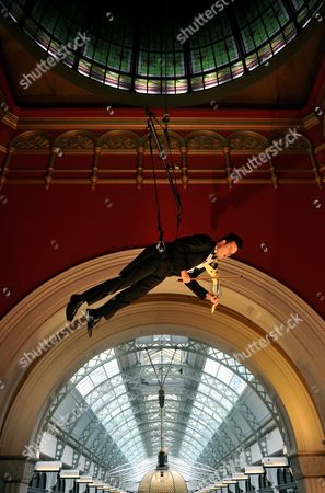 Stock Image of Australian Violinist Shenzo Gregorio Performs While Being Suspended From the Dome of the Queen Victoria Building in Sydney Australia on 16 June 2011 the Performance is the First of a Series of Free Cultural Events Happening Under the Queen Victoria Building Dome Australia Sydney