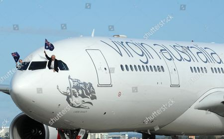 Sir Richard Branson (r) and Virgin Australia Ceo John Borghetti (l) Wave the Australian Flag out of the Cockpit of a Jet Sporting the New Logo of Virgin Australia Group of Airlines at Sydney Airport Sydney Australia on 04 May 2011 to Launch the New Branding For the Virgin Australia Airline Replacing Virgin Blue and V Australia Brands Australia Sydney
