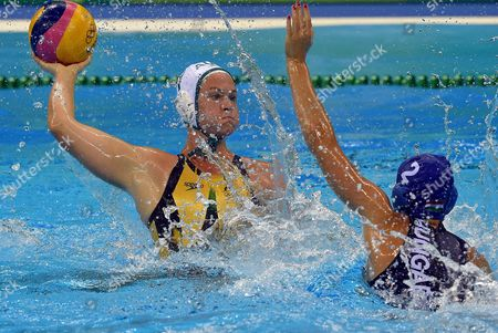 Rowie Webster of Australia Looks to Score Over Dora Czigany of Hungary (right) in Action During the Women's Water Polo Quarterfinal Match of the Rio 2016 Olympic Games Between Australia and Hungary at the Olympic Aquatics Stadium in the Olympic Park in Rio De Janeiro Brazil 15 August 2016 Brazil Rio De Janeiro