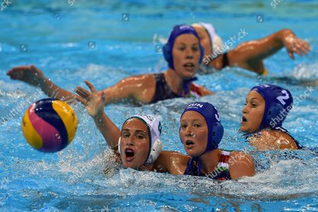 Holly Lincoln-smith of Australia (bottom L) and Dora Antal of Hungary (c-r) in Action During the Women's Water Polo Quarterfinal Match of the Rio 2016 Olympic Games Between Australia and Hungary at the Olympic Aquatics Stadium in the Olympic Park in Rio De Janeiro Brazil 15 August 2016 Brazil Rio De Janeiro