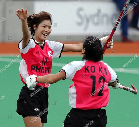 Stock Image of Korea's Seong Eun Kim (l) and Kwang Min Ko Celebrate a Goal in the 2003 Bdo Hockey Champions Trophy Match Against the Netherlands at Sydney Olympic Park Hockey Centre 02 December 2003 the Netherlands Won the Match 4-3 Australia Sydney