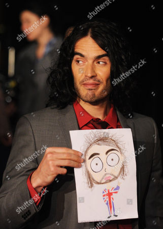 British Comedian Russel Brand Holds Up Fan Art Portrait As He Arrives at the Premiere of His New Film 'Arthur' in Sydney Australia 15 April 2011 Arthur Will Be Released in Cinemas Nationally on April 21 Australia Sydney