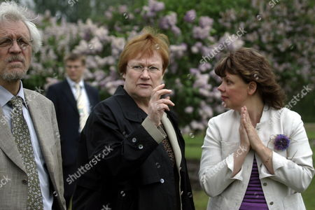 Finland's President Tarja Halonen (c) Pentti Arajarvi (l) and Director of the Latvia State Institute of Fruit-growing Edite Kaufmane (r) During a Visit to the Memorial Museum One of the Most Prominent Latvian Horticulturists and Breeders Peteris Upitis (not Pictured) in Dobele Latvia on 08 June 2010 Tarja Halonen is on Two Days State Visit in Latvia Latvia Dobele