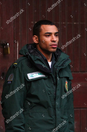 Lloyd Everitt takes a break during filming of BBC drama Casualty on Bute Street in Cardiff Bay