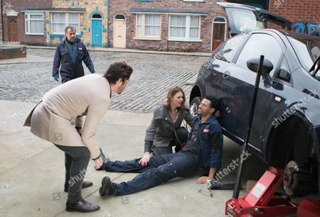 As Adam Barlow, as played by Sam Robertson, and Tracy Barlow, as played by Kate Ford, approach the garage, they're horrified to find Luke Britton, as played by Dean Fagan, trapped under a car. Using a jack, Adam lifts the car and Luke crawls out. When Kevin Webster, as played by Michael Le Vell, admits he wasn't using the safety stand and Luke's accident is entirely his fault, Tracy promises him he hasn't heard the last of this. (Ep 9098 - Fri 10 Feb 2017)
