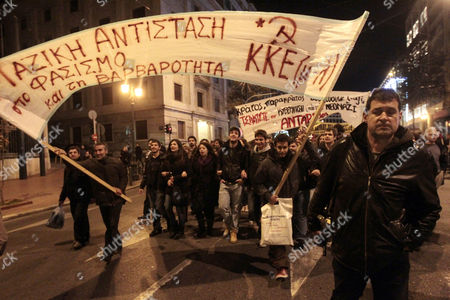 Stock Picture of Antifascist Demonstrators March in Central Athens Despite a Greek Police Announcement Banning Marches For Today 30 November 2013 the Protest was Organized by Antifascist Groups As an Answer to a Rally Called by Golden Dawn ( Chrysi Avgi) Ultra Right Wing Party in Central Syntagma ( Constitution ) Square of Athens at the Same Time Their Banner Reads 'Massive Resistance to Fascism and Barbarity ' Greece Athens
