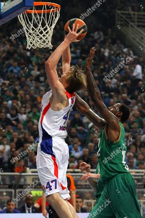 Andrei Kirilenko (l) of Cska Moscow Goes For the Basket Against James Gist (r) of Panathinaikos Athens During the Basketball Euroleague Playoffs Round 3 Match Held Between Panathinaikos Athens and Cska Moscow at O a K a Indoor Hall in Athens Greece 20 April 2015 Greece Athens