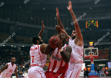 Olympiacos' Josh Powell (c) Goes For the Basket Between Malik Hairston (l) and Ioannis Bourousis (r) of Emporio Armani During the Euroleague Regular Season Game 10 Basketball Match Olympiacos Piraeus Vs Emporio Armani at the 'Peace and Friendship' Stadium of Piraeus Greece on 14 December 2012 Greece Athens