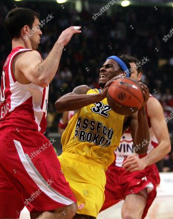Asseco Prokom's Daniel Ewing (r) Fights For the Ball with Olympiacos' Ioannis Bourousis (l) During Their Euroleague Playoffs Basketball Match at the Peace and Friendship Stadium in Athens Greece on 23 March 2010 Greece Athens