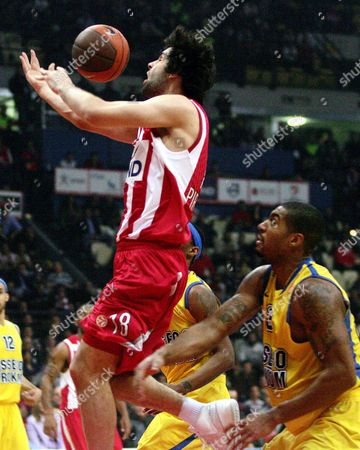 Olympiacos' Milos Teodosic (l) Tries to Stop Prokom's Daniel Ewing (r) During Their Euroleague Playoffs Basketball Match at the Peace and Friendship Stadium in Athens Greece on 23 March 2010 Greece Athens