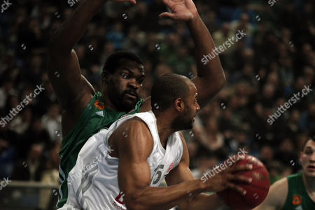 Sofoklis Schortsianitis (l) of Panathinaikos Vies For the Ball with Andrew James Ogilvy (r) of Brose Baskets Bamberg During Their Euroleague Top 16 Basketball Match at the Oaka Indoor Hall in Athens Greece 01 February 2013 Greece Athens