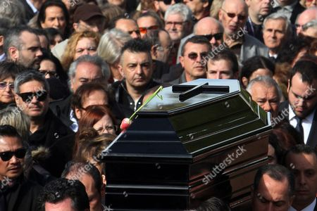 Stock Photo of The Coffin of Greek Singer Demis Roussos is Carried out of a Church After the Funeral Ceremony in Athens Greece 30 January 2015 Roussos Died at the Age of 68 on 25 January Greece Athens