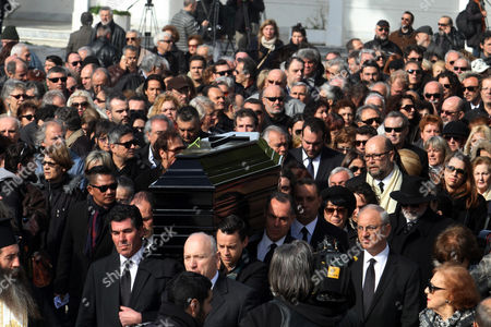 Stock Picture of The Coffin of Greek Singer Demis Roussos is Carried out of a Church After the Funeral Ceremony in Athens Greece 30 January 2015 Roussos Died at the Age of 68 on 25 January Greece Athens