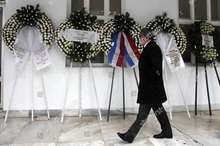 A Man Walks Past Funeral Wreaths During the Funeral Ceremony of Greek Singer Demis Roussos in Athens Greece 30 January 2015 Roussos Died at the Age of 68 on 25 January Greece Athens