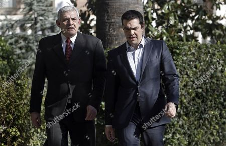 Greek Prime Minister Alexis Tsipras (r) Leaves the Presidential Mansion After a Meeting with Outgoing President Karolos Papoulias (not Pictured) in Athens Greece 04 March 2015 the Greek Government Announced That Finance Minister Yanis Varoufakis Will Present a Folder with Six Reform Proposals to the Eurogroup Meeting on 10 March Greece Athens