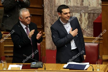 Greek Deputy Prime Minister Yannis Dragasakis (l) Applauds After Greek Prime Minister Alexis Tsipras (r) Delivered His Speech During the Policy Statements of the Government at the Parliament in Athens Greece 08 February 2015 According to Media Reports Tsipras Said That Greece is in Need of a Bridge Loan Greece Athens