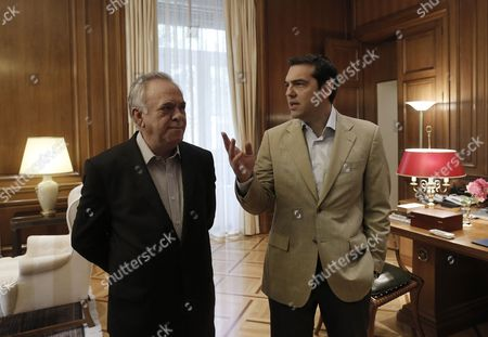 Greek Prime Minister Alexis Tsipras (r) and Government Vice-president Giannis Dragasakis (l) Talks As They Wait For the Arrival of Eu Commissioner For Regional Policy Corina Cretu (not Pictured) During Their Meeting in Athens Greece 20 May 2015 the Government Wants to Secure a Single Agreement with Its Eu Partners Which is what Prime Minister Alexis Tsipras Has Repeatedly Noted Government Sources Said Greece Athens