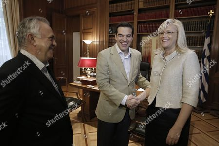 Greek Prime Minister Alexis Tsipras (c) Shakes Hands with Eu Commissioner For Regional Policy Corina Cretu (r) As Government Vice-president Giannis Dragasakis Stands Next to Them During Their Meeting in Athens Greece 20 May 2015 the Government Wants to Secure a Single Agreement with Its Eu Partners Which is what Prime Minister Alexis Tsipras Has Repeatedly Noted Government Sources Said Greece Athens