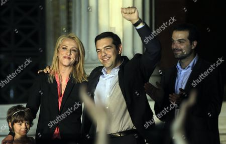 Alexis Tsipras (c) Leader of the Opposition and the Leader of the Coalition of the Radical Left (syriza) Rena Dourou (l) New Elected Candidate of the Party As Local Governor of the Region of Athens and Gabriel Sakellaridis (r) Candidate of the Party As Mayor of Athens who Failed to Be Elected Celebrate with Supporters the Results of the European Parliamentary Elections and the Second Round of the Local Administration Elections in a Pre Election Kiosk of the Syriza Party in Athens Greece 25 May 2014 the European Elections Which Run From 22 to 25 May Will Form a New European Parliament Whose 751 Members Will Help Set Laws in the European Union For Five Years to Come About 400 Million People in the 28-country Bloc Are Eligible to Vote Greece Athens