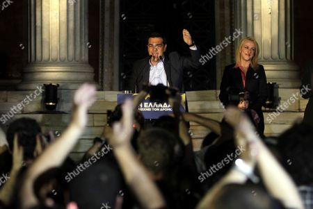 Alexis Tsipras (c) Leader of the Opposition and the Leader of the Coalition of the Radical Left (syriza) Rena Dourou (r) and New Elected Candidate of the Party As Local Governor of the Region of Athens Celebrate with Supporters the Results of the European Parliamentary Elections and the Second Round of the Local Administration Elections in a Pre Election Kiosk of the Syriza Party in Athens Greece 25 May 2014 the European Elections Which Run From 22 to 25 May Will Form a New European Parliament Whose 751 Members Will Help Set Laws in the European Union For Five Years to Come About 400 Million People in the 28-country Bloc Are Eligible to Vote Greece Athens
