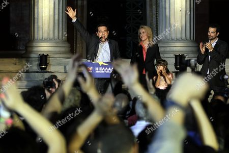 Alexis Tsipras (l) Leader of the Opposition and the Leader of the Coalition of the Radical Left (syriza) Rena Dourou (c) New Elected Candidate of the Party As Local Governor of the Region of Athens and Gabriel Sakellaridis (r) Candidate of the Party As Mayor of Athens who Failed to Be Elected Celebrate with Supporters the Results of the European Parliamentary Elections and the Second Round of the Local Administration Elections in a Pre Election Kiosk of the Syriza Party in Athens Greece 25 May 2014 the European Elections Which Run From 22 to 25 May Will Form a New European Parliament Whose 751 Members Will Help Set Laws in the European Union For Five Years to Come About 400 Million People in the 28-country Bloc Are Eligible to Vote Greece Athens