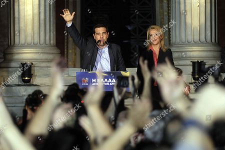 Alexis Tsipras (l) Leader of the Opposition and the Leader of the Coalition of the Radical Left (syriza) and Rena Dourou (r) New Elected Candidate of the Party As Local Governor of the Region of Athens Celebrate with Supporters the Results of the European Parliamentary Elections and the Second Round of the Local Administration Elections in a Pre Election Kiosk of the Syriza Party in Athens Greece 25 May 2014 the European Elections Which Run From 22 to 25 May Will Form a New European Parliament Whose 751 Members Will Help Set Laws in the European Union For Five Years to Come About 400 Million People in the 28-country Bloc Are Eligible to Vote Greece Athens