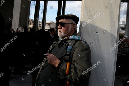 A Man Smokes During the Funeral of Greek Director Theo Angelopoulos in Athens Greece 27 January 2012 Theo Angelopoulos Died in a Road Accident in the Early Hours on 25 January 2012 While Working on His Latest Movie Near Athens He was 76 Greece Athens