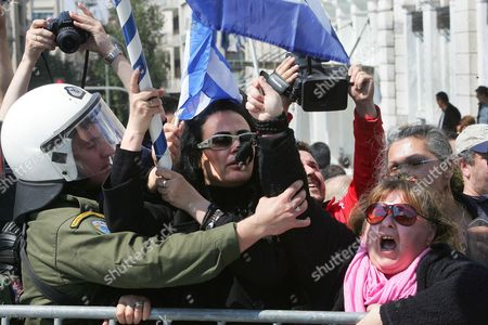 Far-right Wing Protesters Are Pushed Back by Riot Police During a Parade on Greek Independence Day in Athens Greece on 25 March 2011 Members of the Extreme-right Organization Chrysi Avgi Attacked Immigrant Street Vendors Before the Start of the Military Parade in the Central Athens Marking the 190th Anniversary of the March 25 1821 Revolution Against Ottoman Rule Greece Athens