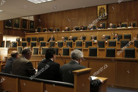Stock Image of Former Finance Minister George Papaconstantinou (3-l) Sits in the Plenary Court Room of the Supreme Court (areios Pagos) in Athens Greece 24 February 2015 at the Start of a Trial Over His Handling of the So-called Lagarde List of Greece's Large-scale Depositors in a Swiss Bank Others Are not Identified Papaconstantinou is Facing the Criminal Charges of Tampering with a Public Document and Attempted Breach of Trust Greece Athens