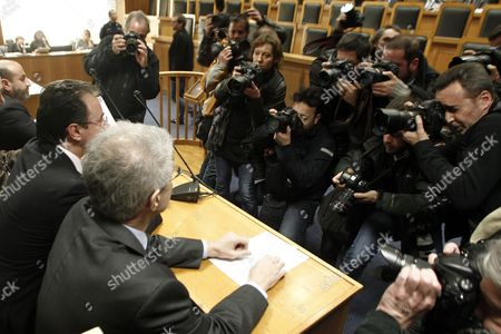 Former Finance Minister George Papaconstantinou (l) is in the Focus of the Media As He Sits in the Plenary Court Room of the Supreme Court (areios Pagos) in Athens Greece 24 February 2015 at the Start of a Trial Over His Handling of the So-called Lagarde List of Greece's Large-scale Depositors in a Swiss Bank Others Are not Identified Papaconstantinou is Facing the Criminal Charges of Tampering with a Public Document and Attempted Breach of Trust Greece Athens