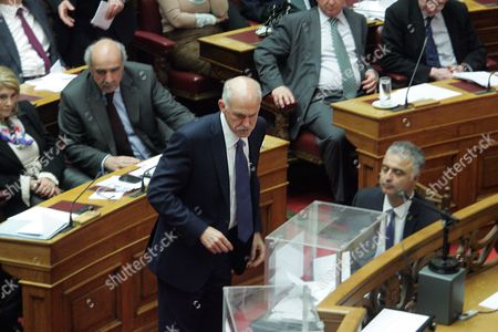 Greek Former Prime Minister George Papandreou Casts His Ballot After a Debate at the Greek Parliament in Athens Greece 18 January 2013 the Greek Parliament was Set to Vote on Whether to Launch a Formal Investigation Into Accusations That Two Former Prime Ministers Had Failed to Take Action on the So-called Lagarde List That Identified Multi-millionaires Suspected of Tax Evasion the List Contains the Names of More Than 2 000 Greek Citizens with Huge Deposit Accounts at a Geneva Branch of Hsbc It was Given to Former Finance Minister George Papaconstantinou by His Then-counterpart Christine Lagarde of France in 2010 Greece Athens