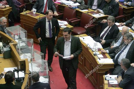 Greek Main Opposition Syriza Party Leader Alexis Tsipras (l) Casts His Ballot After a Debate at the Greek Parliament in Athens Greece 18 January 2013 the Greek Parliament was Set to Vote on Whether to Launch a Formal Investigation Into Accusations That Two Former Prime Ministers Had Failed to Take Action on the So-called Lagarde List That Identified Multi-millionaires Suspected of Tax Evasion the List Contains the Names of More Than 2 000 Greek Citizens with Huge Deposit Accounts at a Geneva Branch of Hsbc It was Given to Former Finance Minister George Papaconstantinou by His Then-counterpart Christine Lagarde of France in 2010 Greece Athens