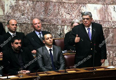 Greek Ultra-right Wing Golden Dawn Party Leader Nikos Michaloliakos (r) Addresses the Greek Parliament in Athens Greece 17 January 2013 the Greek Parliament was Set to Vote on Whether to Launch a Formal Investigation Into Accusations That Two Former Prime Ministers Had Failed to Take Action on the So-called 'Lagarde List' That Identified Multi-millionaires Suspected of Tax Evasion the List Contains the Names of More Than 2 000 Greek Citizens with Huge Deposit Accounts at a Geneva Branch of Hsbc It was Given to Former Finance Minister George Papaconstantinou by His Then-counterpart Christine Lagarde of France in 2010 Greece Athens