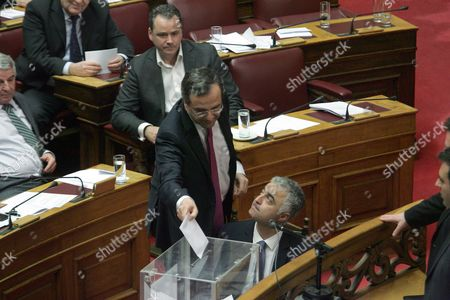 Greek Prime Minister Antonis Samaras Casts His Ballot After a Debate at the Greek Parliament in Athens Greece 18 January 2013 the Greek Parliament was Set to Vote on Whether to Launch a Formal Investigation Into Accusations That Two Former Prime Ministers Had Failed to Take Action on the So-called Lagarde List That Identified Multi-millionaires Suspected of Tax Evasion the List Contains the Names of More Than 2 000 Greek Citizens with Huge Deposit Accounts at a Geneva Branch of Hsbc It was Given to Former Finance Minister George Papaconstantinou by His Then-counterpart Christine Lagarde of France in 2010 Greece Athens