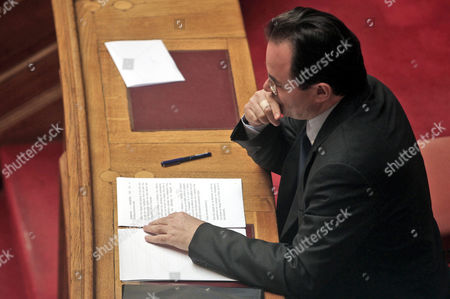 Former Pasok Finance Minister George Papaconstantinou Prepares His Speech in the Greek Parliament in Athens Greece 17 January 2013 the Greek Parliament was Set to Vote on Whether to Launch a Formal Investigation Into Accusations That Two Former Prime Ministers Had Failed to Take Action on the So-called Lagarde List That Identified Multi-millionaires Suspected of Tax Evasion the List Contains the Names of More Than 2 000 Greek Citizens with Huge Deposit Accounts at a Geneva Branch of Hsbc It was Given to Former Finance Minister George Papaconstantinou by His Then-counterpart Christine Lagarde of France in 2010 Greece Athens